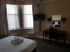 A television and/or entertainment centre at The Crown Hotel