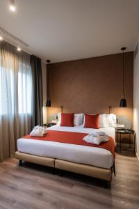 Un ou plusieurs lits dans un hébergement de l'établissement Atenea Rekord Suites