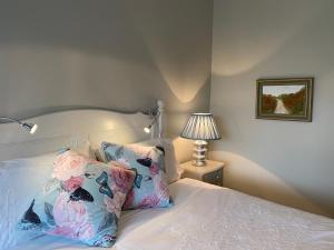 A bed or beds in a room at River Meadows B&B