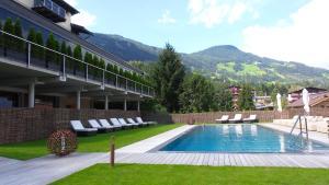 The swimming pool at or near Aktiv- und Wellnesshotel Haidachhof superior