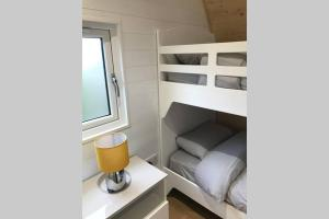A bunk bed or bunk beds in a room at The Burrow