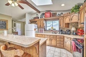 A kitchen or kitchenette at Lake of the Ozarks Home with Game Room, BBQ and Dock!