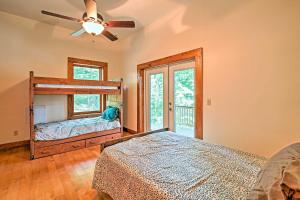 A bunk bed or bunk beds in a room at Large Lavonia Lakefront Log Cabin with Boat Slip
