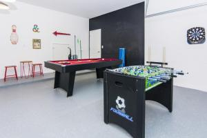 A billiards table at Golf View Vacation Homes