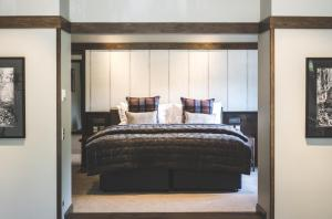 A bed or beds in a room at Gibbston Valley Lodge and Spa