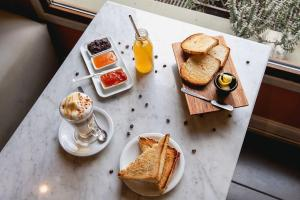 Breakfast options available to guests at Hotel Cap Polonio
