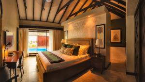 A bed or beds in a room at Warwick Le Lagon Resort & Spa, Vanuatu