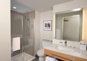 A bathroom at Hotel Indigo Denver Downtown, an IHG Hotel