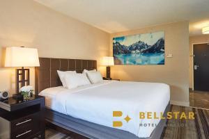 A bed or beds in a room at Grande Rockies Resort-Bellstar Hotels & Resorts