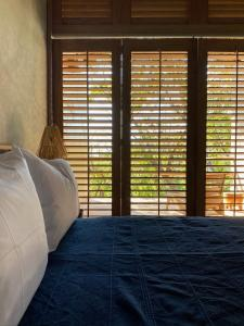 A bed or beds in a room at Monte Uzulu Boutique Hotel