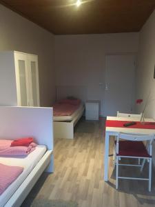Ein Bett oder Betten in einem Zimmer der Unterkunft Hotel Restaurant Müther