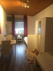 Ein Sitzbereich in der Unterkunft Hotel Restaurant Müther