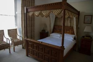 A bed or beds in a room at The Grove Falmouth