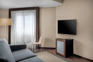 A television and/or entertainment center at AC Hotel by Marriott Oviedo Forum