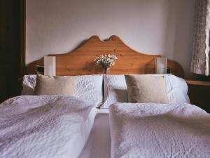 A bed or beds in a room at B&B Mia Majon