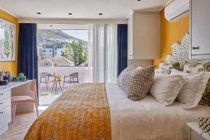 A bed or beds in a room at Pineapple House Boutique Hotel