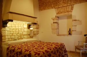 A bed or beds in a room at Trulli Soave