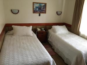 Cama o camas de una habitación en Hotel Encanto del Río
