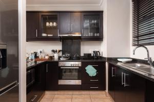 A kitchen or kitchenette at Point Boutique Rentals