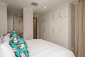 A bed or beds in a room at Point Boutique Rentals