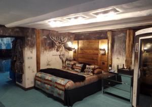 Un ou plusieurs lits dans un hébergement de l'établissement La Bergerie du Miravidi