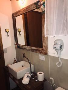 Um banheiro em Pousada de Charme Emirados