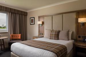 A bed or beds in a room at Radstone Hotel