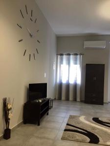 A television and/or entertainment center at Meteora House- Cozy Living