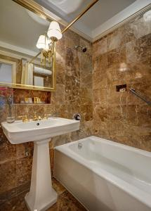 A bathroom at Hotel Elysee by Library Hotel Collection