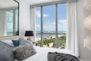 A bed or beds in a room at W South Beach Residences 1BR Ocean View