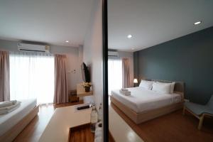 A bed or beds in a room at Sukhothai Garden