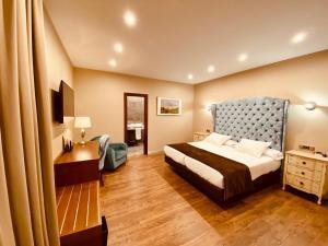 Ein Bett oder Betten in einem Zimmer der Unterkunft Hotel Palace Sevilla