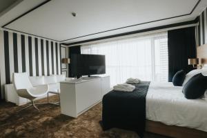 Telewizja i/lub zestaw kina domowego w obiekcie Hotel Sułkowski Conference Resort