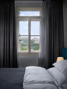 Letto o letti in una camera di MOODs boutique hotel