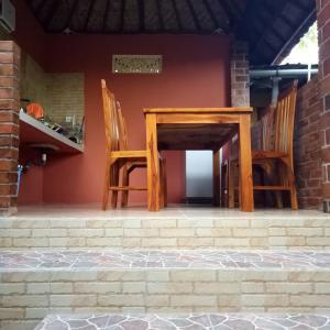 Eine Fassade oder ein Eingang zu Mulia Home Stay