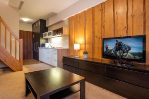Kuchyňa alebo kuchynka v ubytovaní Via Jasna Wellness Apartments