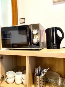 A kitchen or kitchenette at Hayk Altstadthotel & Appartements