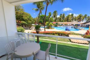 A view of the pool at Hotel Praia Dourada or nearby