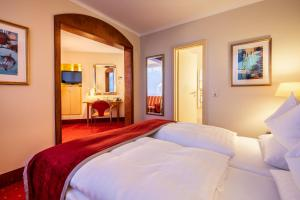 A bed or beds in a room at SETA Hotel