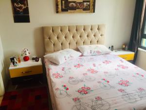 A bed or beds in a room at Falcon Palas Hotel