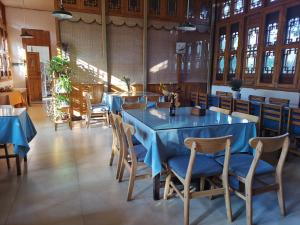 A restaurant or other place to eat at Nirvana Organic Farm Inn