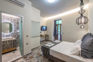 Un ou plusieurs lits dans un hébergement de l'établissement Casa Poli Suites