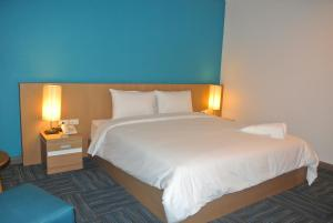 A bed or beds in a room at S Tara Grand