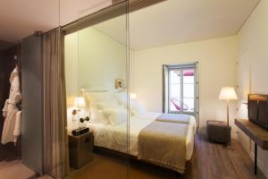 A bed or beds in a room at Memmo Alfama - Design Hotels