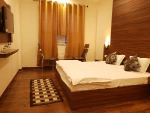 A bed or beds in a room at Rama Residency