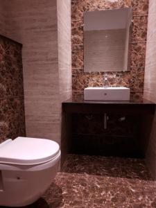 A bathroom at Rama Residency