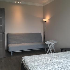 A bed or beds in a room at I Горнолыжникам и Биатлонистам apartment on Komsomolskaya 279a