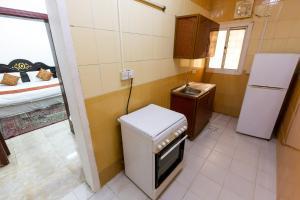 Um banheiro em Al Eairy Apartments - Jeddah 5