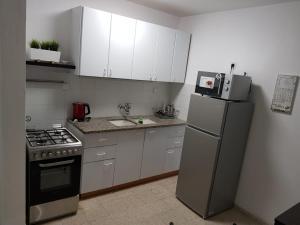 מטבח או מטבחון ב-דירת נופש בוטיק - נוף לרבי שמעון