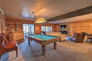 A pool table at Pristine Flagstaff Cabin with Decks and Mountain Views!